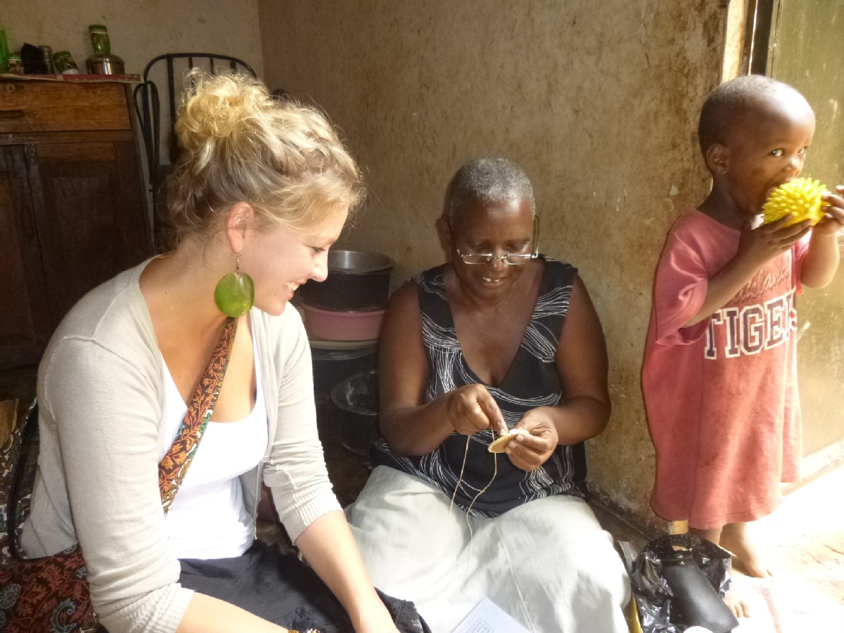 Volunteer Anik Doven from Netherlands carrying out training in hand craft to vulnerable households in Buloba parish.