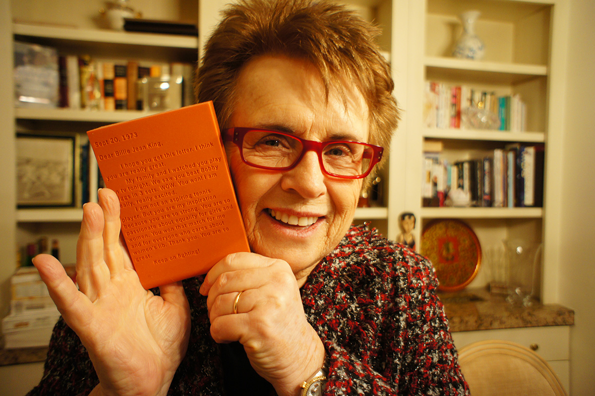 Billie Jean King at home holding The Thing, 2013.