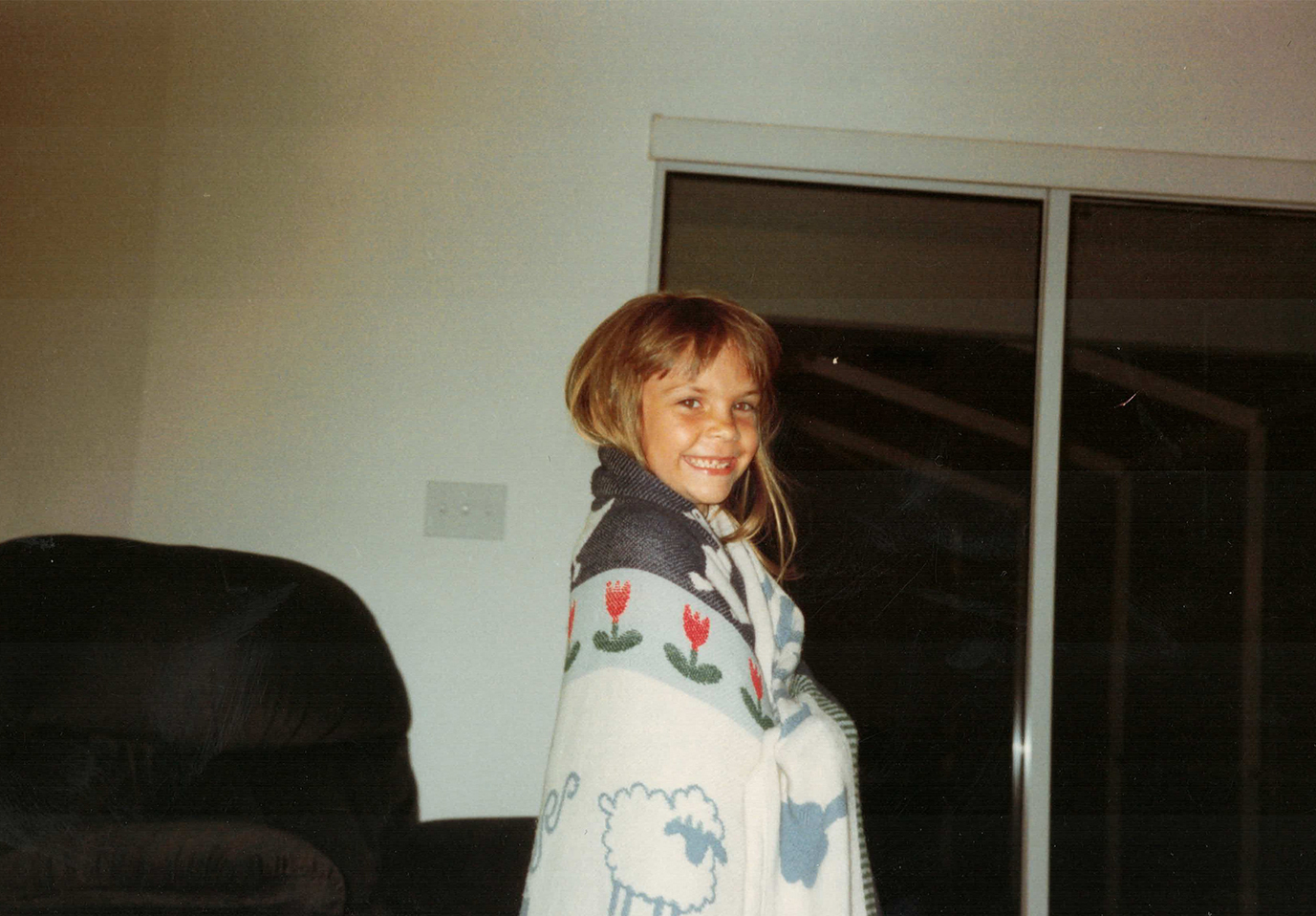 Me, messy-haired and snaggle-toothed…like any respectable kid should be.