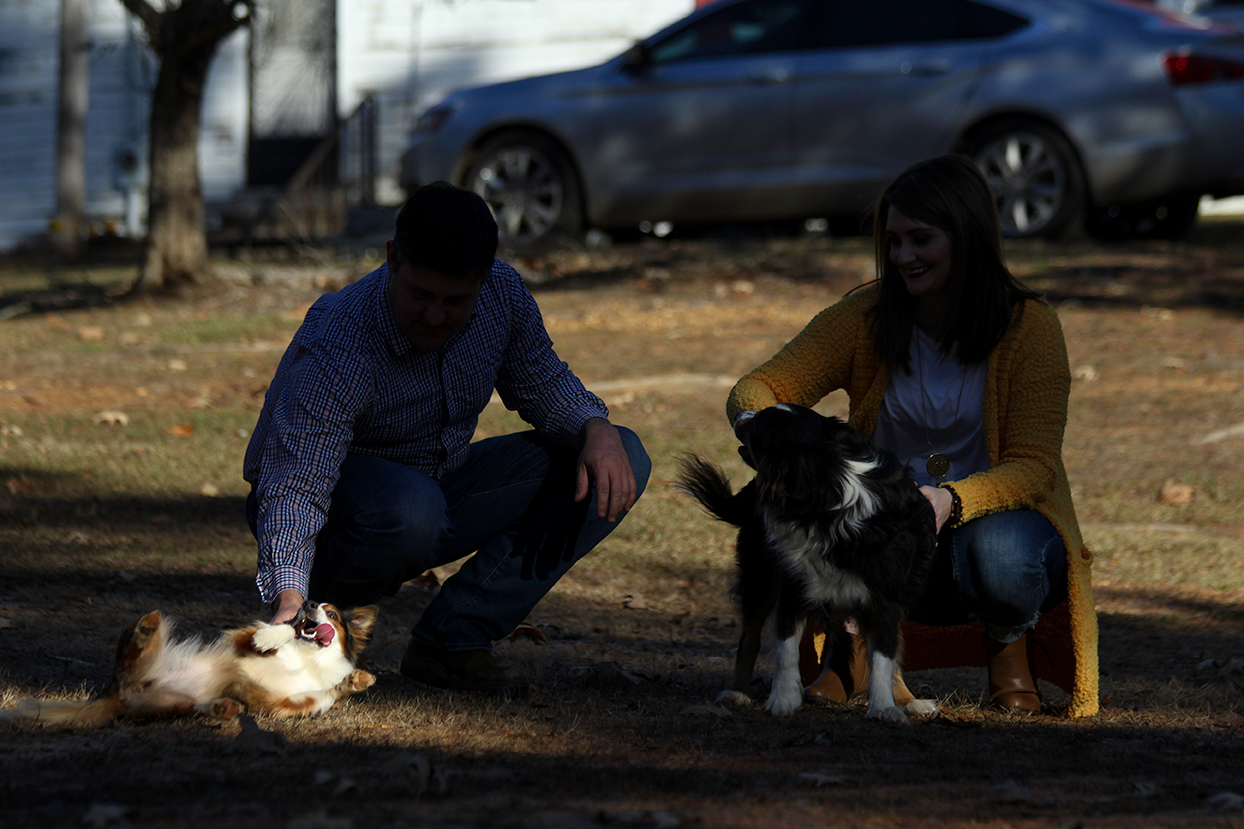dog-rolling-on-ground-tongue-out-couple-mini-session-documentary-family-photography-north-mississippi.jpg