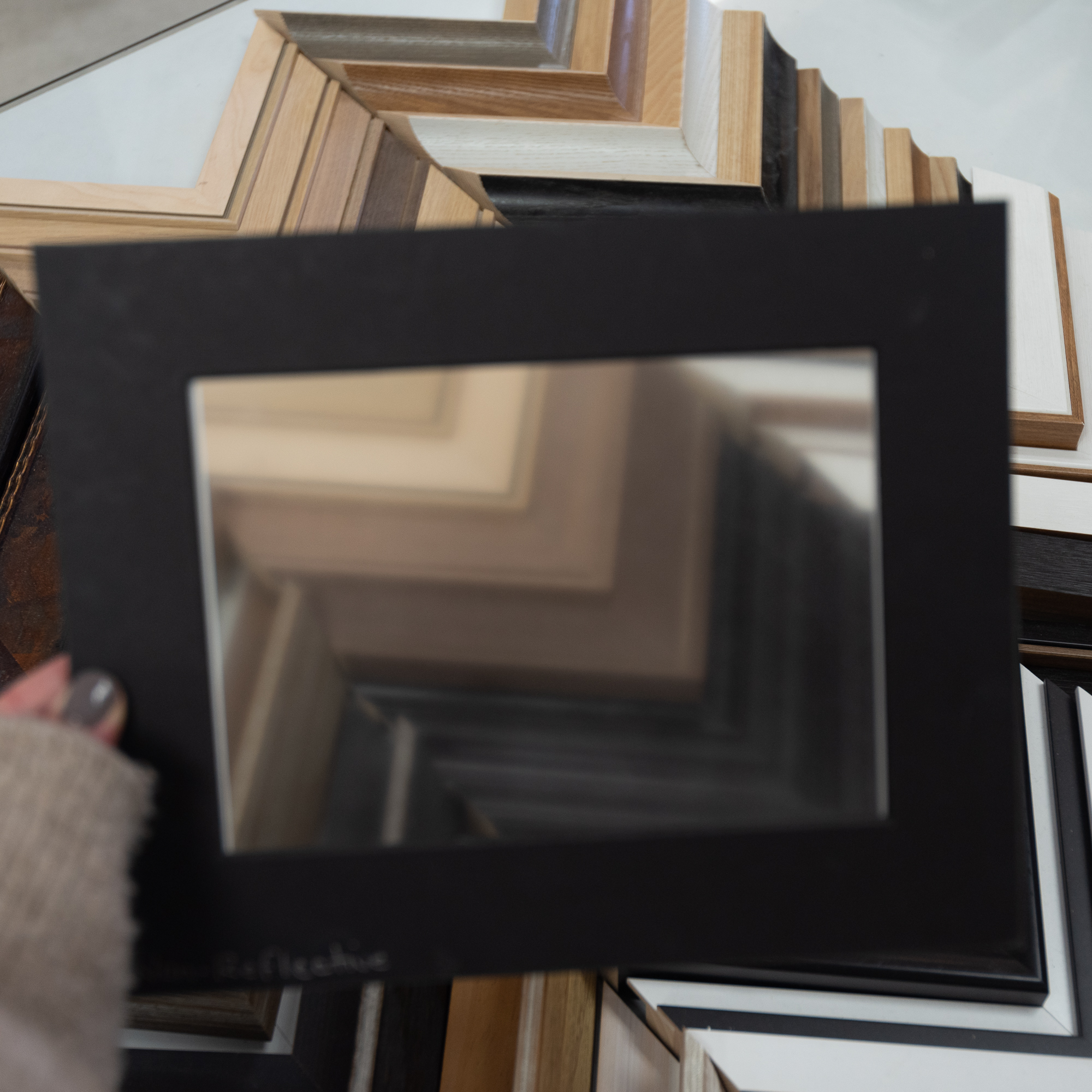 Traditional Non-Reflective Glass - blurs the subject when placed at a distance
