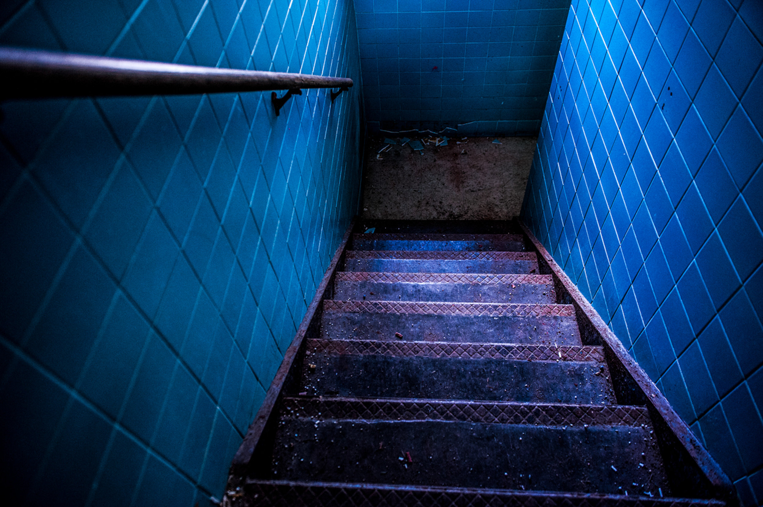 Blue stairs, oppressively soundless, save the blistered  clatter of young girls walking lockstep.
