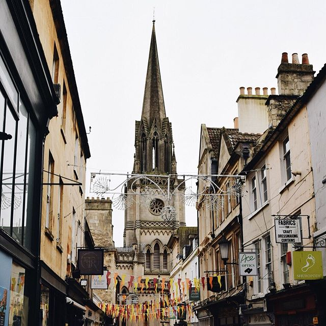 """Bath was a bit... Austen-tacious. ✨📚✨ . . . . """"Do you know, I get so immoderately sick of Bath"""" Northanger Abbey, Jane Austen. I might have grown to hate Bath too if I had to live there but for a weekend trip it will do just nicely. I spent the majority of my visit seeking out the history of Jane Austen's years here. . . . . . taking afternoon tea was downright essential though and the tea on offer at the Jane Austen centre is too cute. I sat under a portrait of Mr Darcy, the servers are dressed in empire lined gowns and the scones and sandwiches are served on willow patterned china. Have you been to Bath? Ever travelled somewhere because of a book or a film?"""