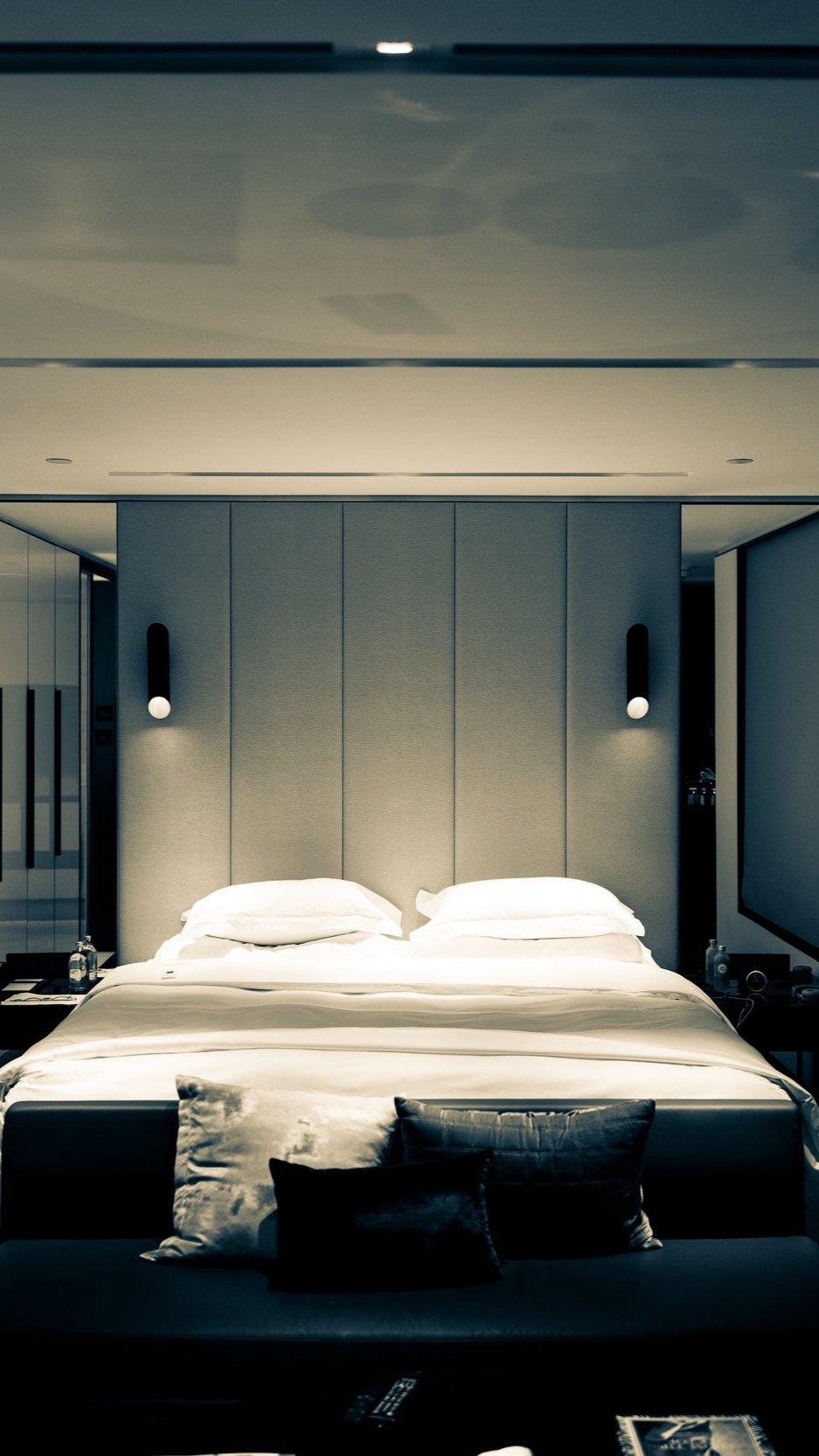 A bed in a luxury hotel room