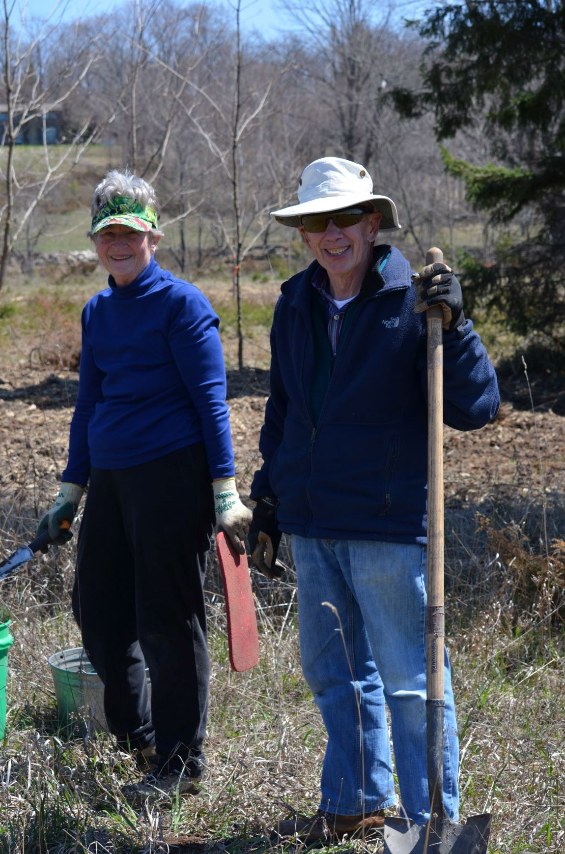 Mary and Dick Smythe, CCCDC Steering Committee members, plant trees at the Spring Public Tree Planting in Ellison Bay, WI on May 4, 2019.
