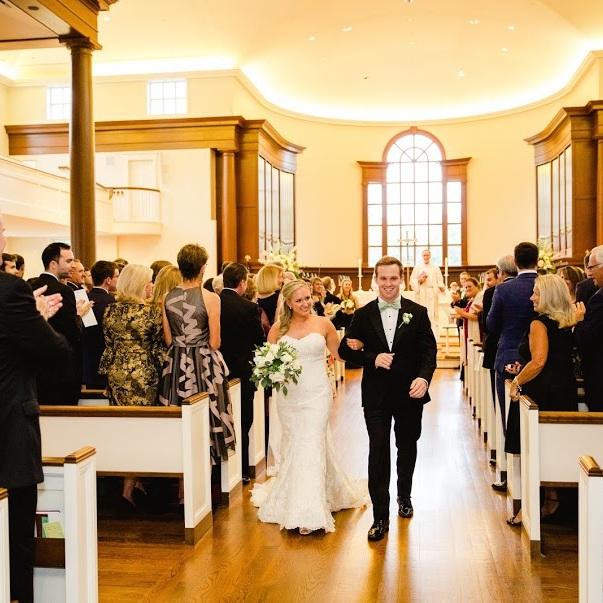 Wedding couple walking down aisle
