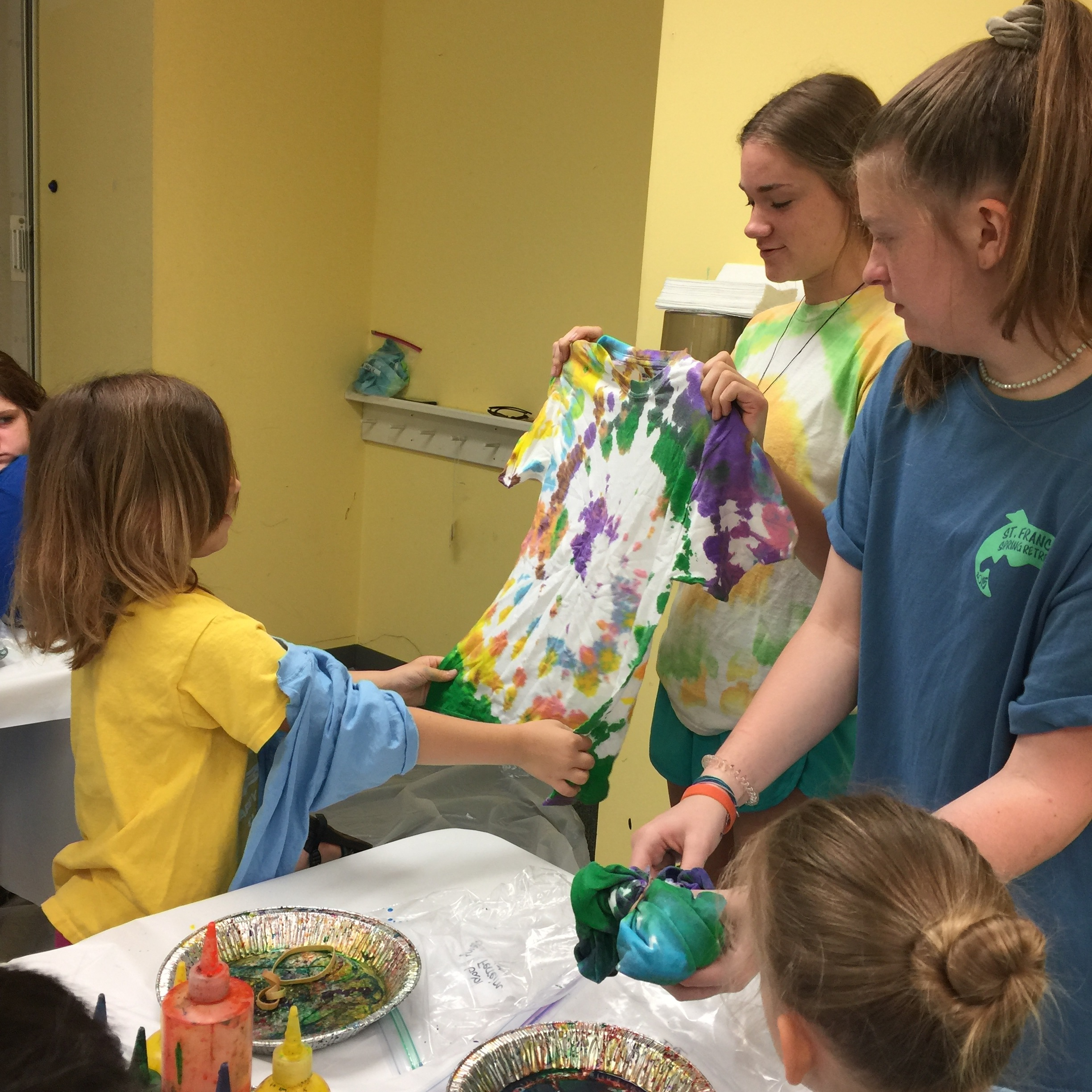Tie-dying shirts with kids at VBS