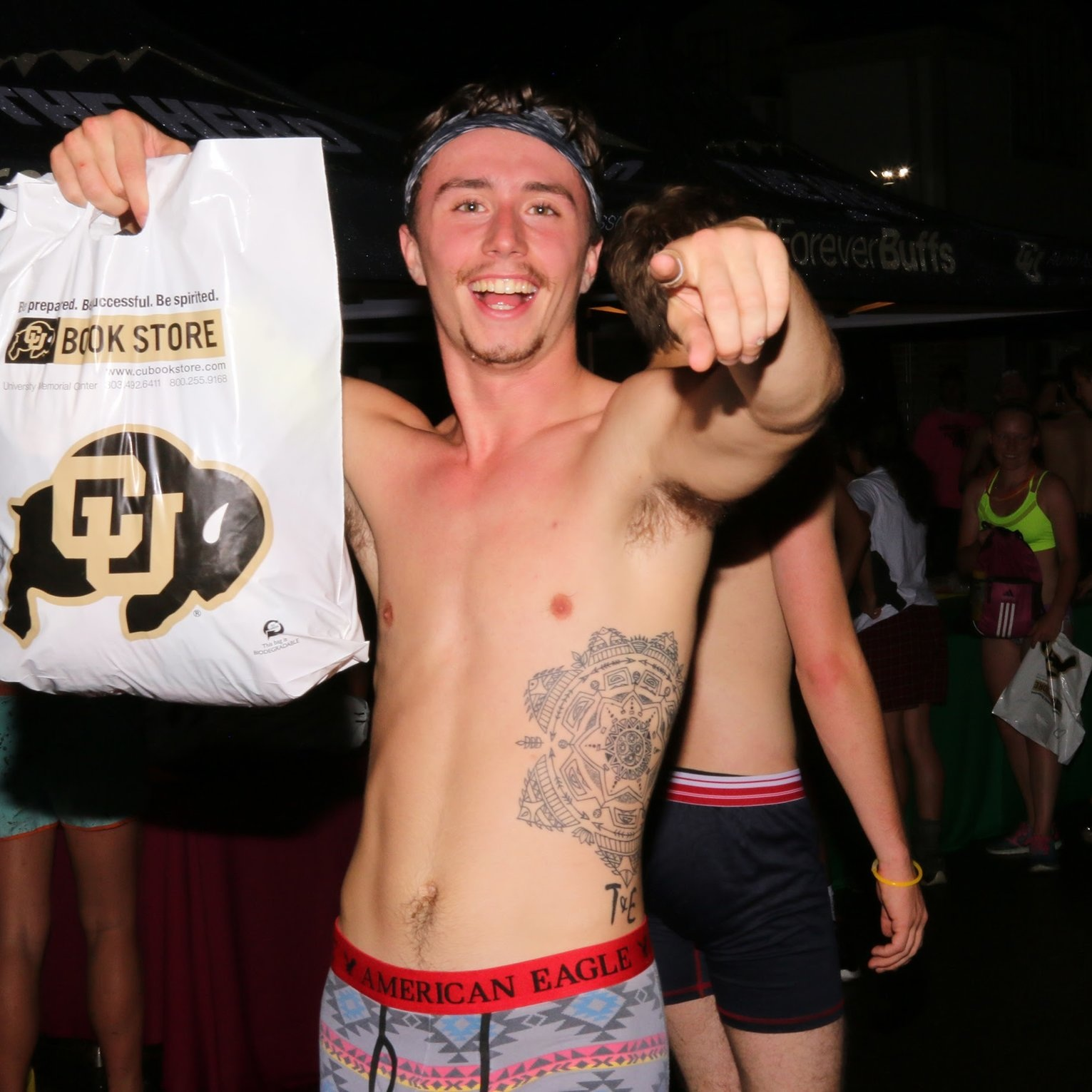 """CU gets """"nearly naked"""" for charity drive - CU students ran """"nearly naked"""" for charity at The Herd's thirteenth annual Nearly Naked Mile donation drive Friday night."""