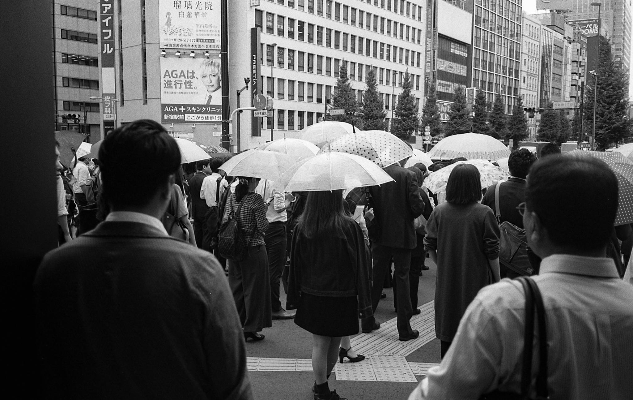 Passersby under plastic shields (Tokyo) (Olympus Mju-II Ilford HP5+)