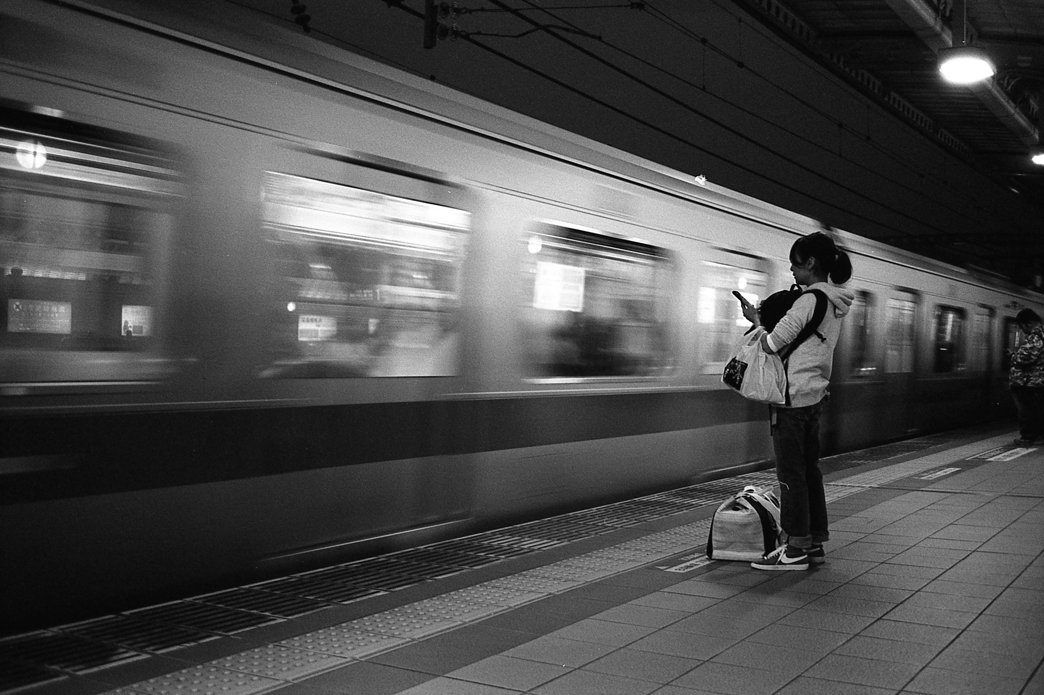 Waiting for the train (Olympus Mju-II Ilford HP5+ pushed to 1600)