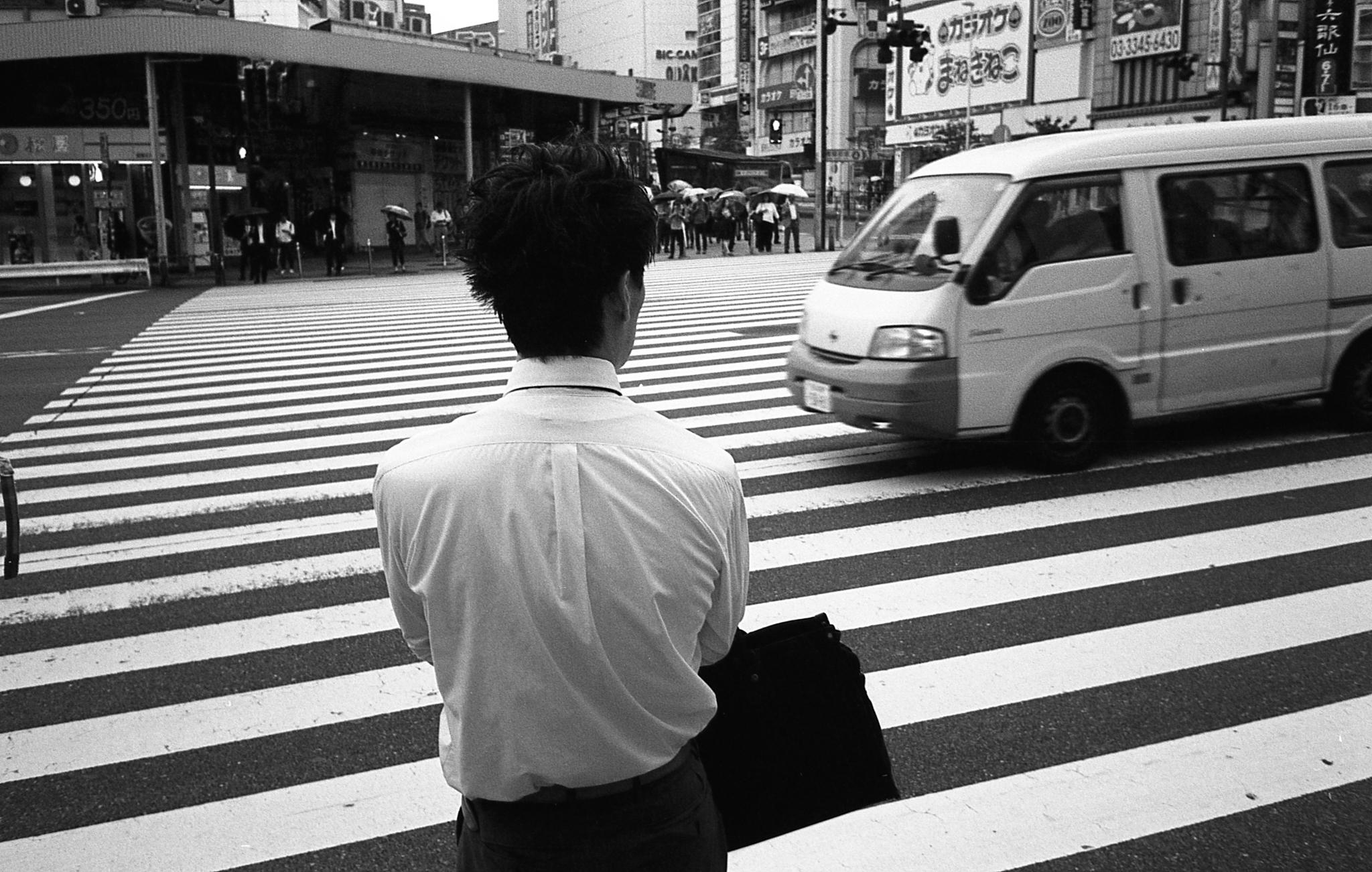 Guy crossing (Olympus Mju-II Ilford HP5+)