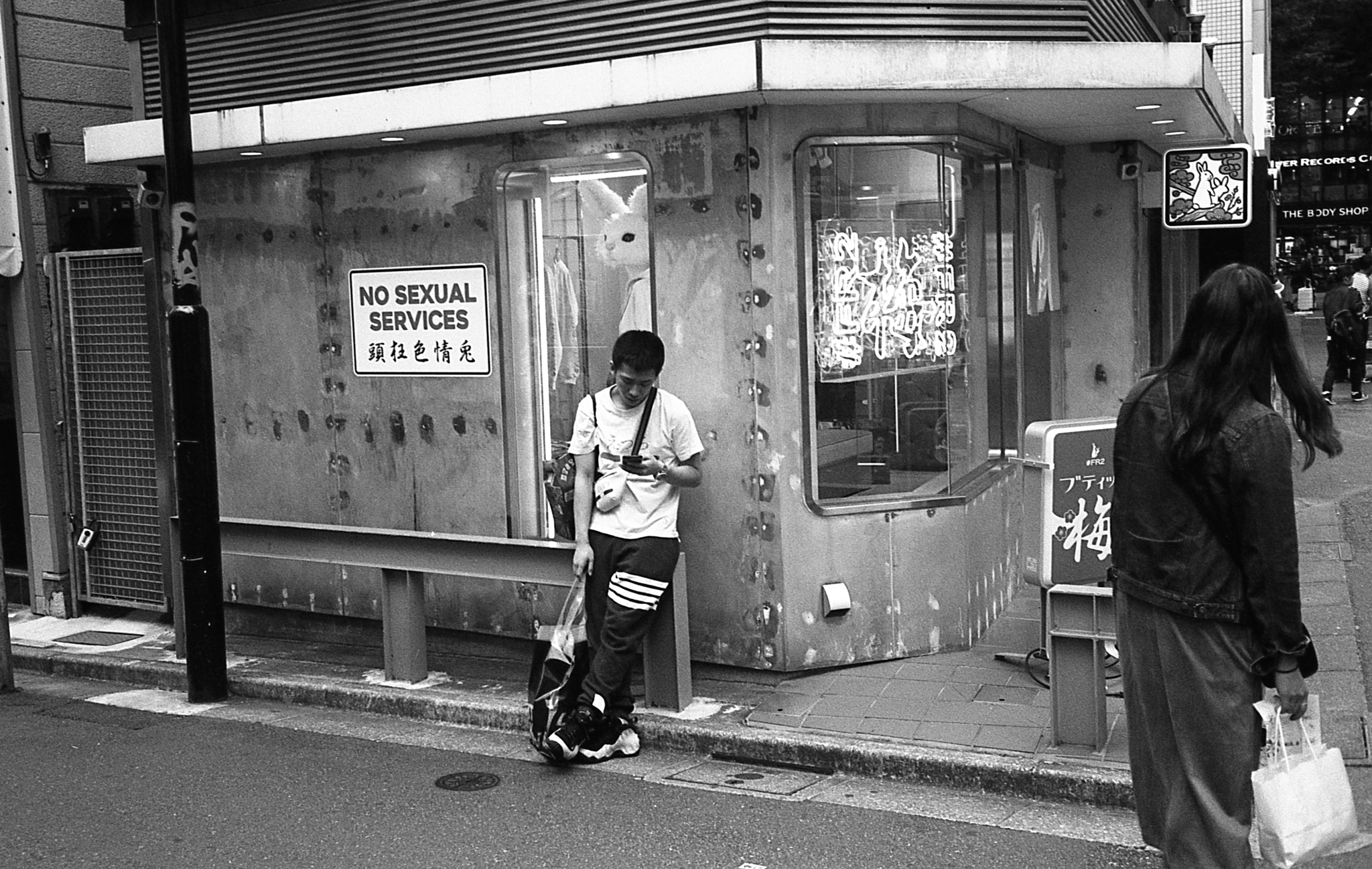 Looks can be deceiving - especially white humanoid rabbits, a symbol of sexuality awkwardly positioned in the curious realms of Tokyo's audacious underbelly.  (Olympus Mju-II Ilford HP5+)