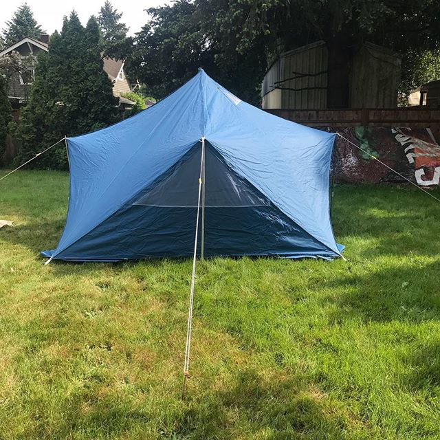 """Tent #17 the last tent of the day!! This is a Blue 10x10 made out of an unknown material it is very dark inside. It has a 5"""" stove hole, side windows and a screen front. This is the 100th 10x10 TT ever made and it goes for $400."""