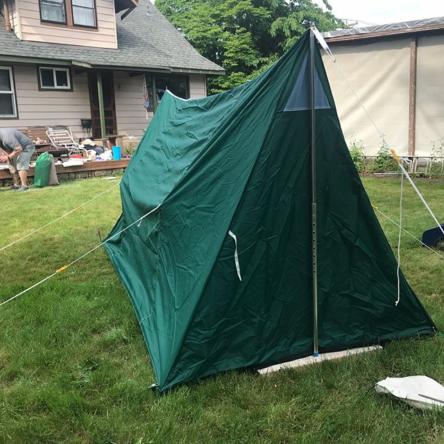 Tent #16. This is a fun little tent that we call a Pup Tent. It is a green Nylon 5'x9.5' with a 5' height. It also has a sewn in floor and a screen front. Comes with new poles. This tent goes for $250.