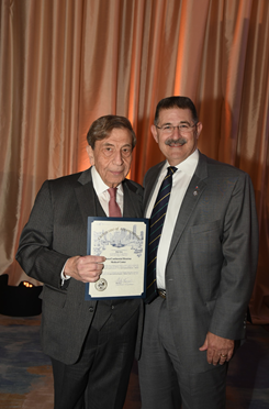 Hotel owner Monzer Hourani with Councilman Mike Knox   photo credit: Alexander's Fine Portrait Designs