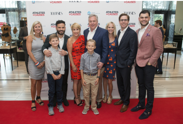 Donna and Norman Lewis and Family with Jose Altuve and Lance McCullers   photo by Jacob Power