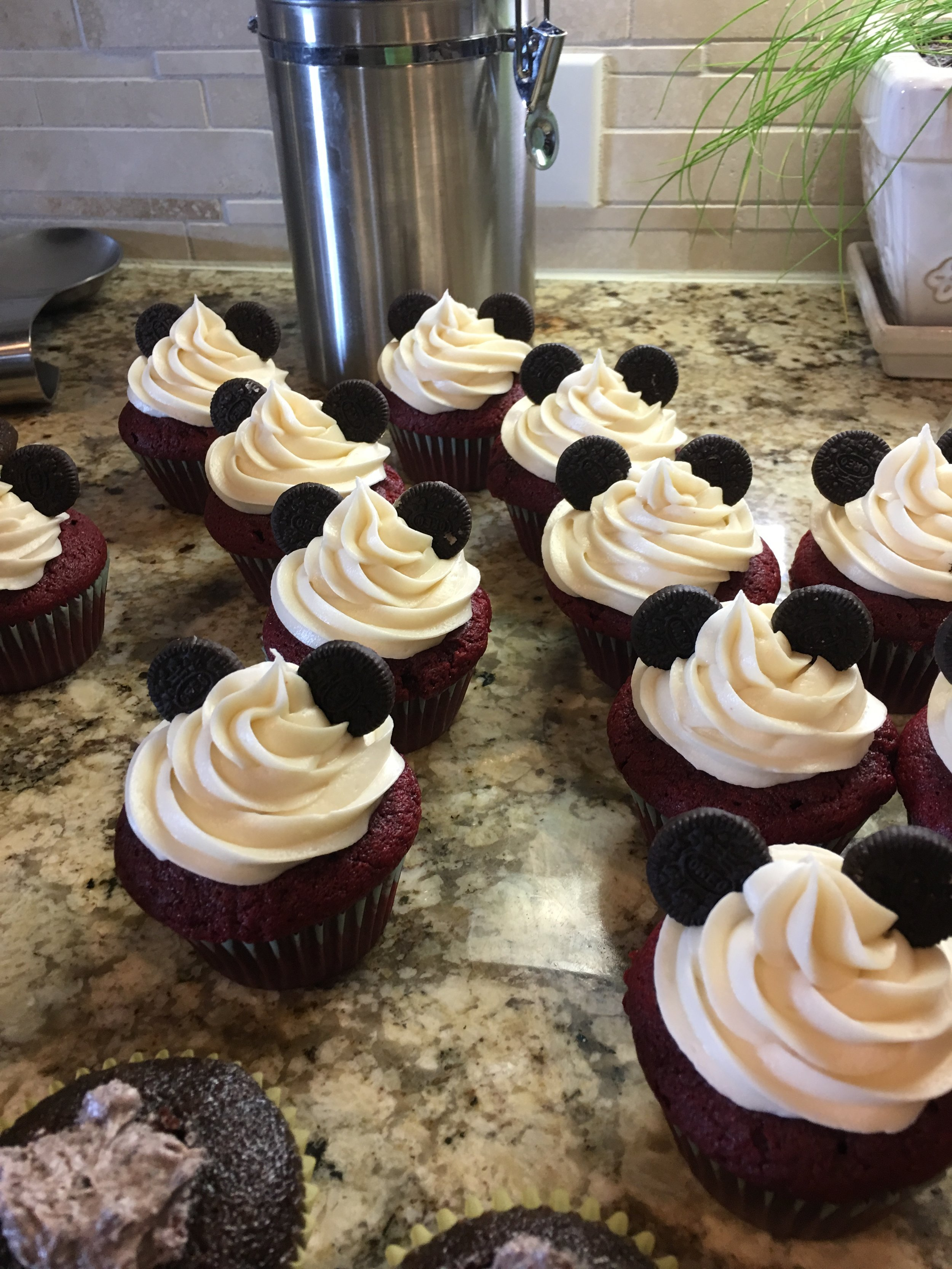 baking and decorating red velvet cupcakes with Oreos