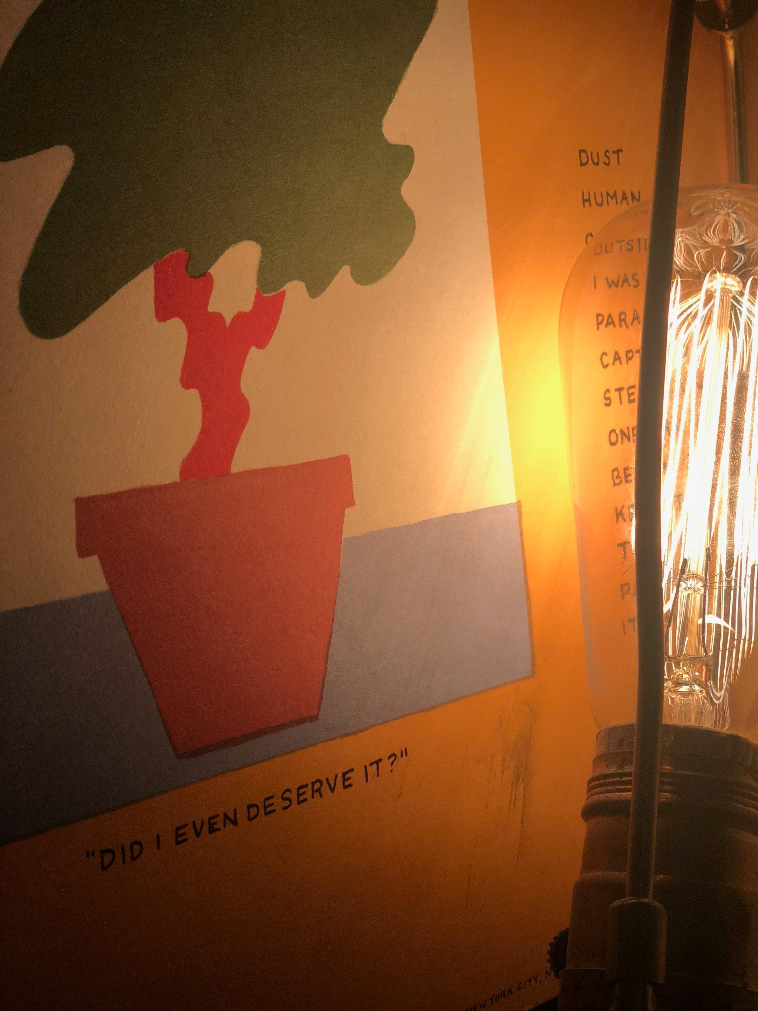 retro lightbulb illuminating books