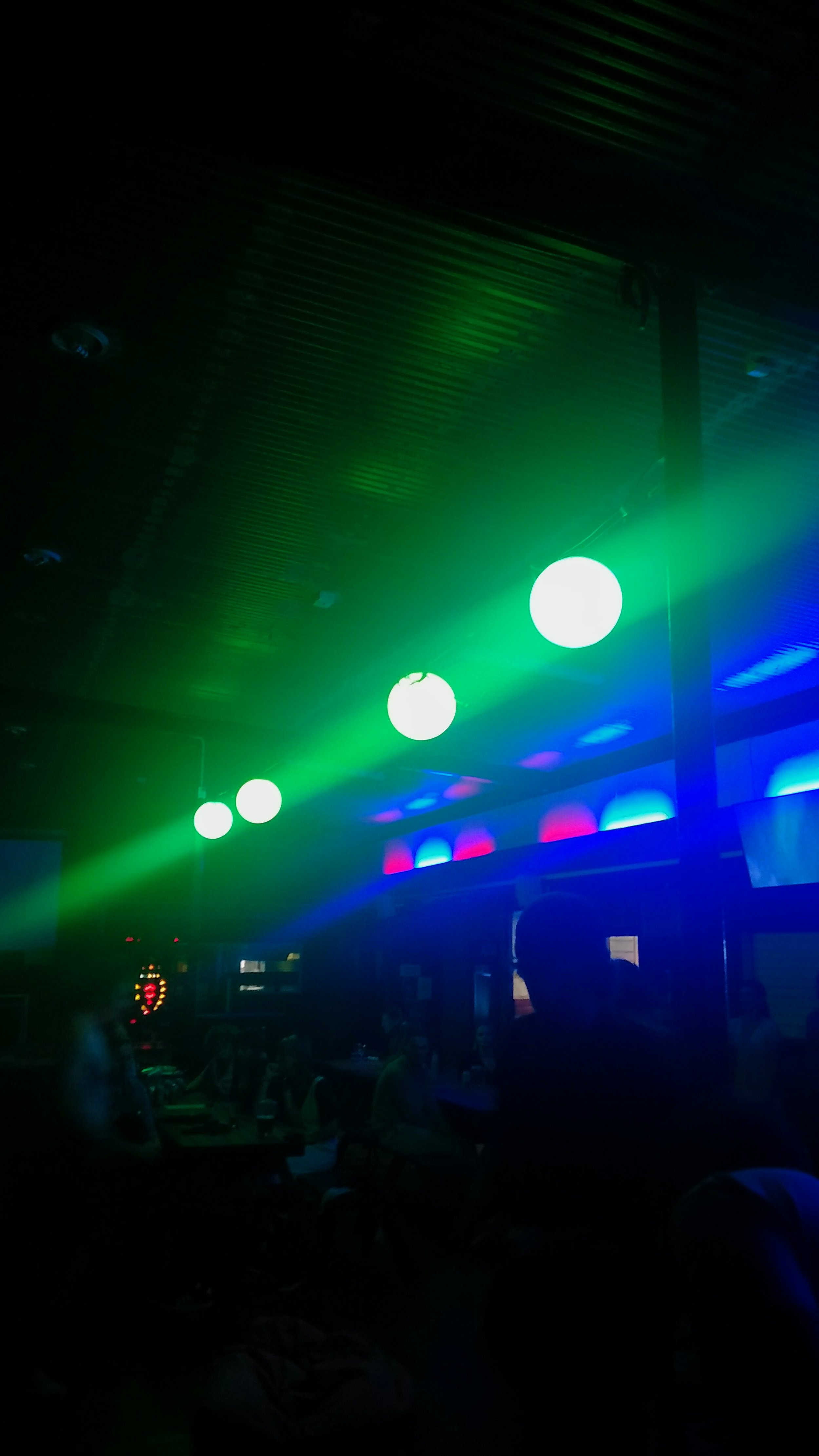 Neon green and blue lights in bar