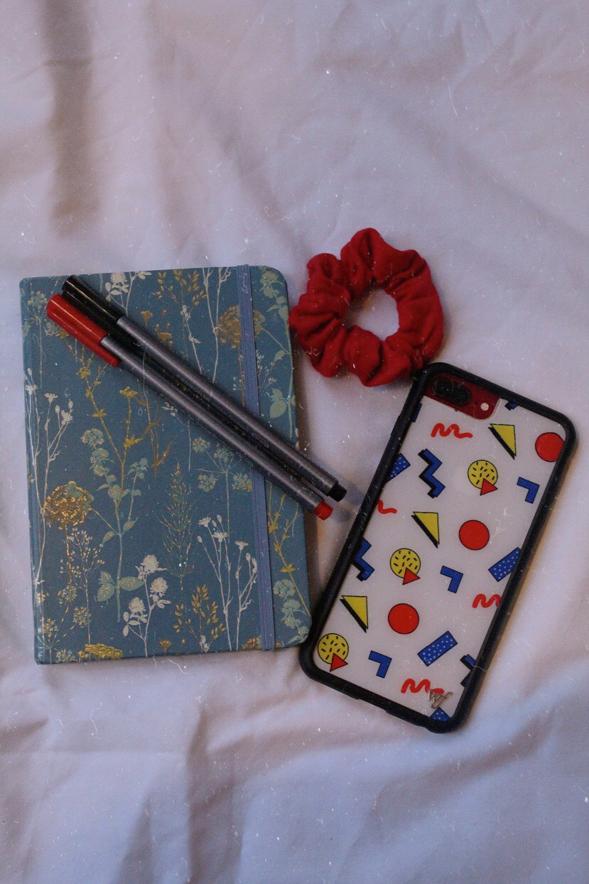 Notebook and pens with hair scrunchie and cute phone case