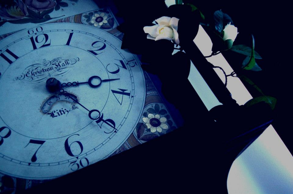 Grandfather clock with flowers