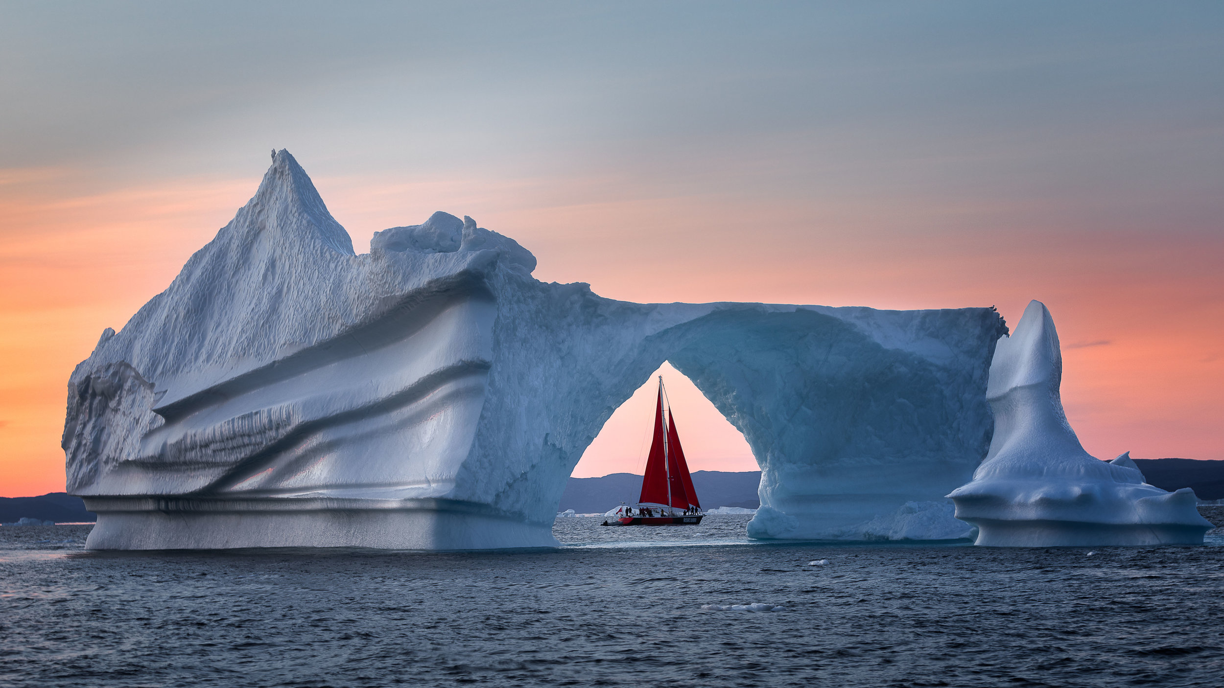 Midnight sun and red sail