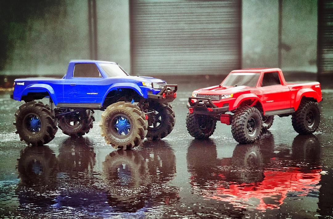The Mega Truck next to a stock Sport