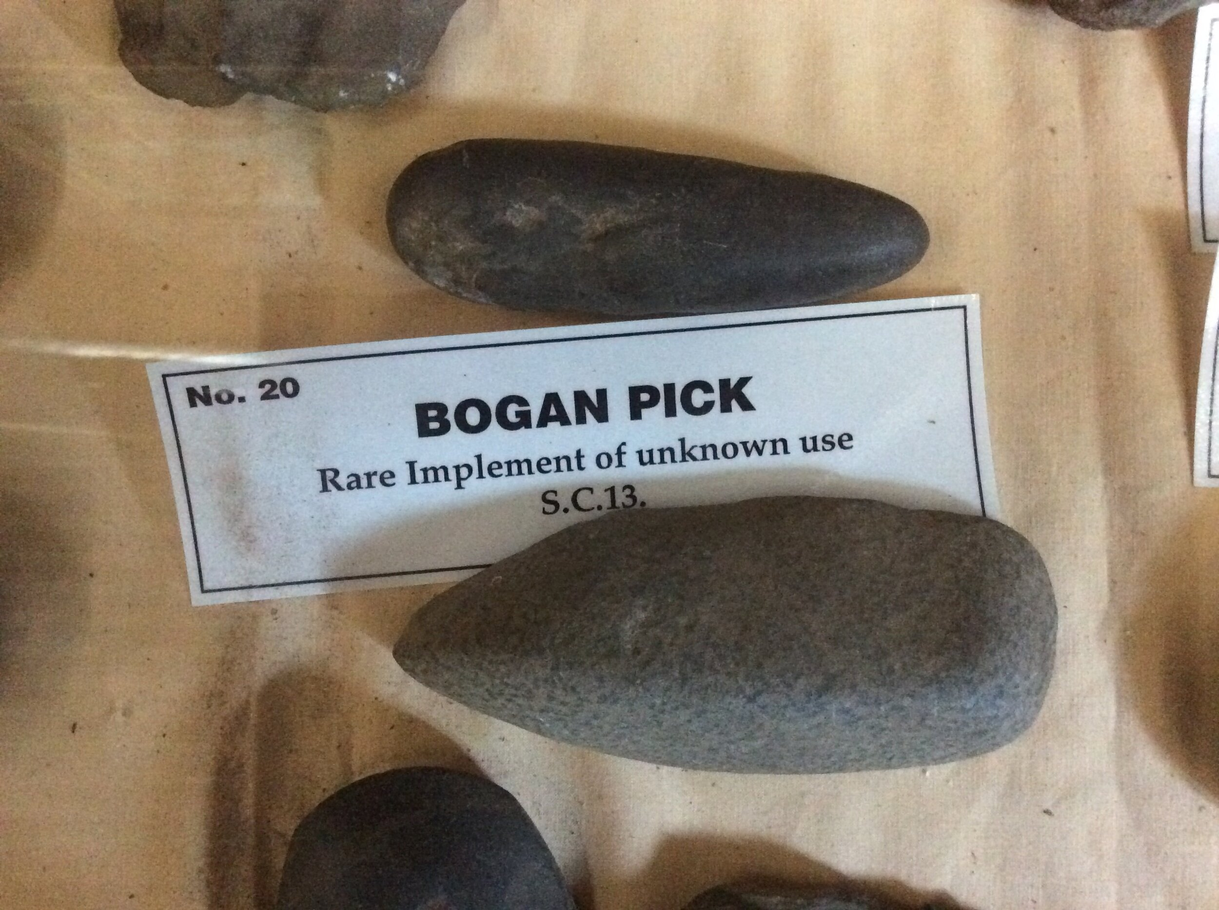 - Aboriginal stone artefacts in Gulgong Museum (NSW, Australia). It seems that there is no recorded knowledge, or even an Aboriginal oral history, as to what these rare and mysterious Bogan picks were actualy used for. If they were the soil-cultivating 'hoes' that Mr Pascoe claims, then there would have recorded explorer observations of Aboriginal women tilling the soil with a hafted (wooden-handled) Bogan pick and many more would have been collected with their handles in place. In addition, the local Aborigines would have told the early explorers and ethnographers about them and their use. In reality, the historical record is silent, leading us to conclude they were not used as Mr Pascoe would have us believe.
