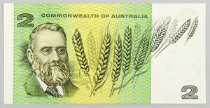 The Australian agronomist and plant breeder William Farrer and 'his' wheat graced the $2 currency from 1966 until 1988 when it was replaced by the $2 coin below - Designed by Gordon Andrews. - Source     Wikipedia