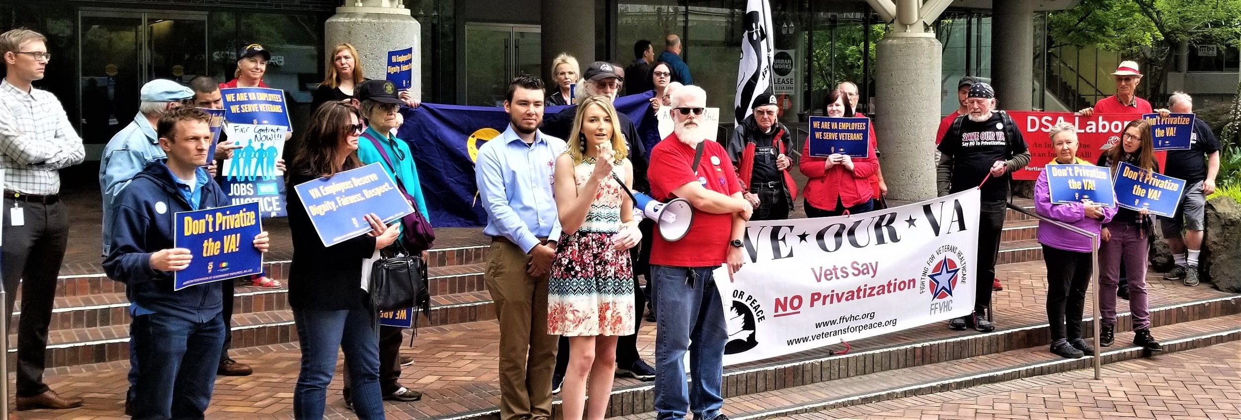 """Paige Kreisman, the first woman to serve as an Indirect Fire Infantryman in the US Army, now a disabled veteran, speaks at the Portland """"Save Our VA"""" rally in support of the VA workers union. (2019)"""