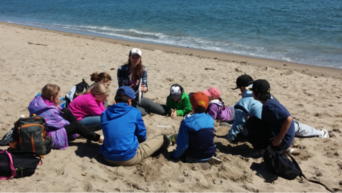 Gabby teaching a beach lesson during her time as an Educator at The Ecology School.