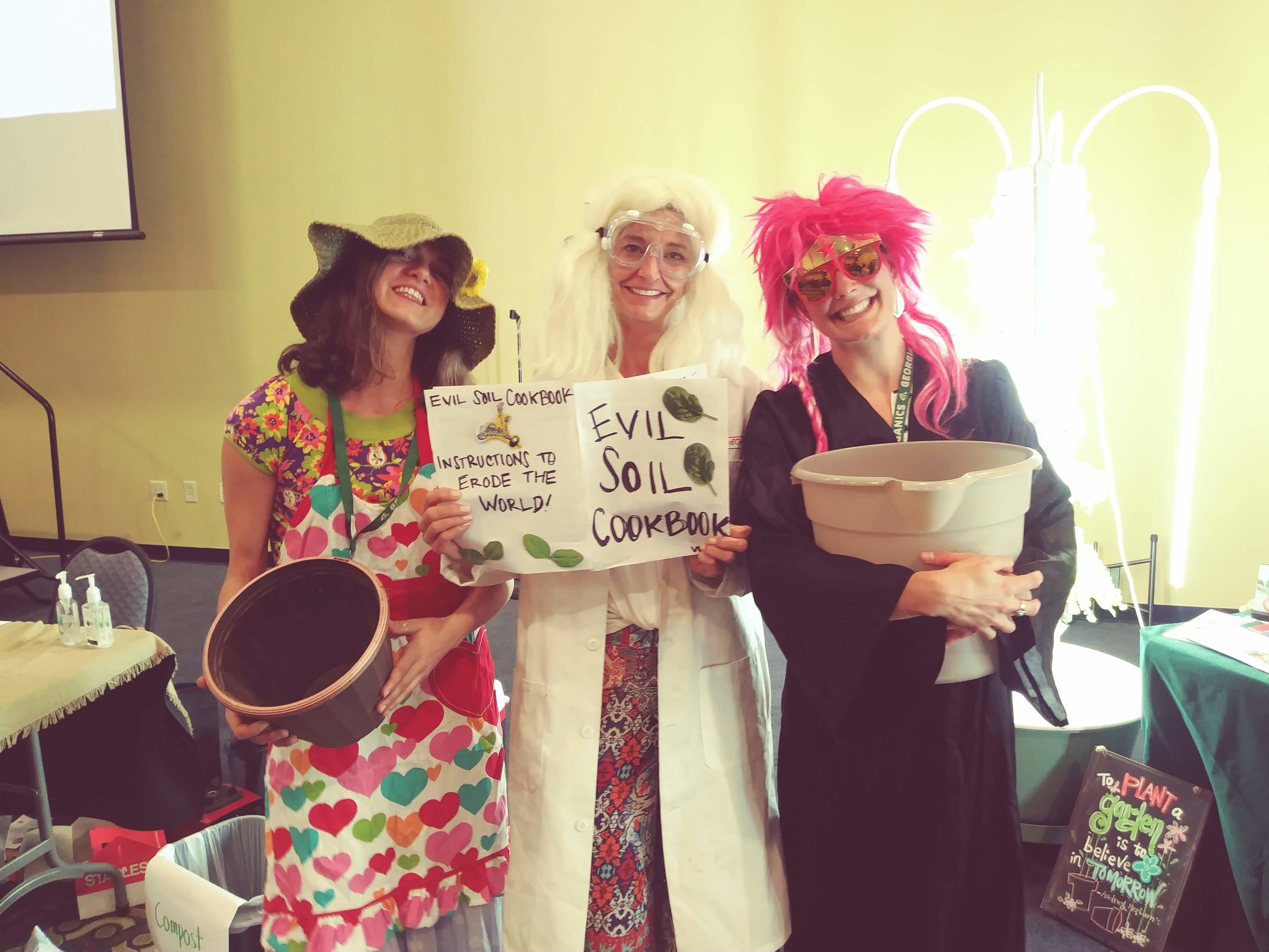 Three teachers pose in familiar costumes during a  Grow It. Know It . training. (Doc Rock and Igor are on the far right!)