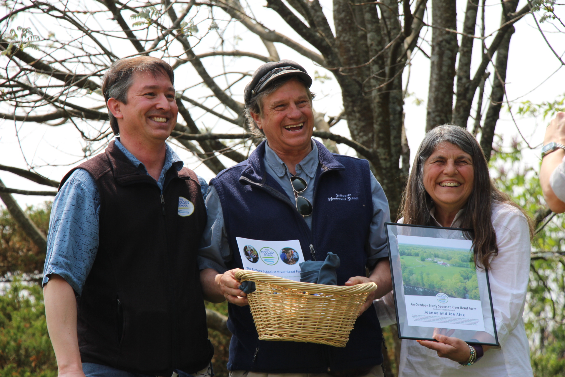 Drew Dumsch, The Ecology School President & CEO, presents Joe and Joanne Alex with recognition of their named outdoor study space on June 1, 2019.