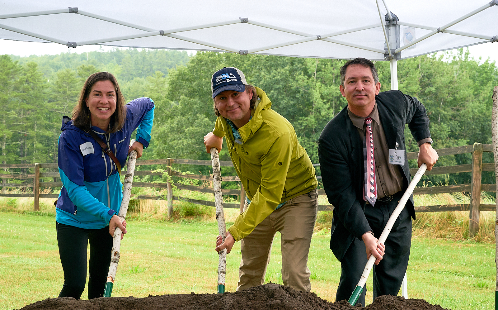 Hannah Quimby, Zak Klein, and Drew Dumsch (left to right) at The Ecology School's Groundbreaking Ceremony for River Bend Farm in Summer 2019.