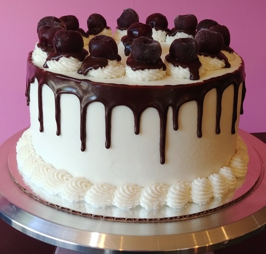 Black Forest - Chocolate Cake, Filled with Cherry Compote, Topped with Vanilla Frosting, Ganache & Cherries.