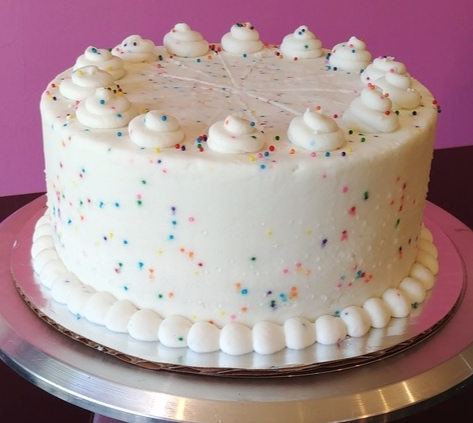 Confetti - Vanilla Sprinkle Cake, Filled with Tie-Dye Vanilla Frosting, Topped with Vanilla Sprinkle Frosting.