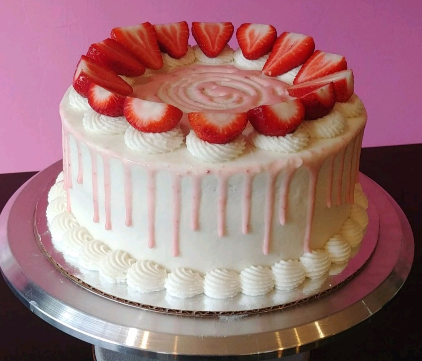 Strawberry Shortcake - Vanilla Cake, Filled with Strawberry Jam, Topped with Vanilla Frosting, Strawberry Slices & Strawberry Glaze.