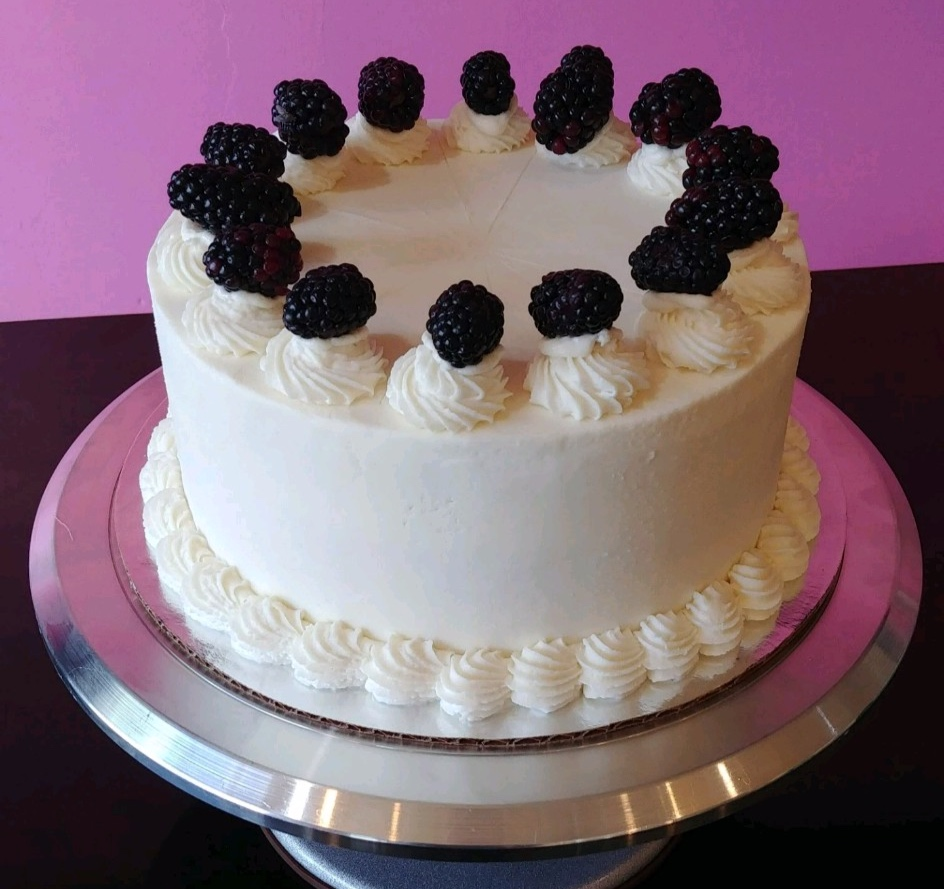 The Lilly - Lemon Cake, Filled with Cranberry Jam, Orange Frosting & Blackberry Garnishes.