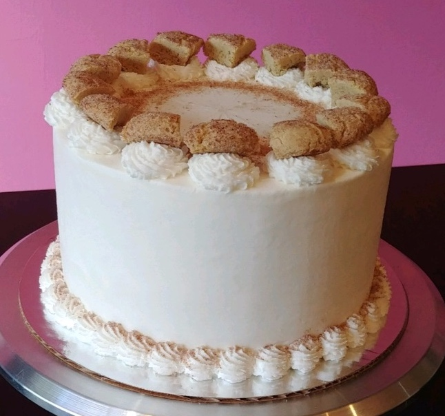 Snickerdoodle - Cinnamon Cake, Filled with Cinnamon Frosting, Topped with Vanilla Frosting & Snickerdoodle Cookie Pieces.