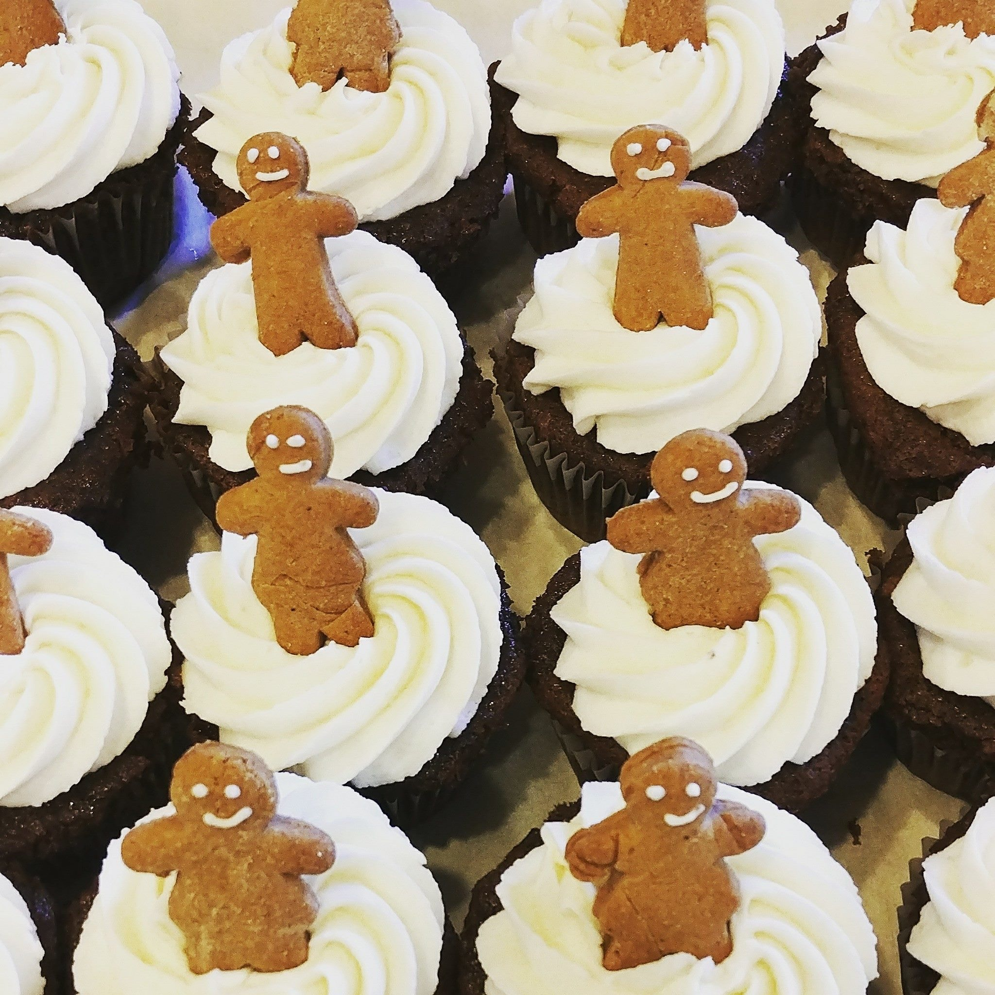 Gingerbread - Gingerbread Cake, Filled with Ginger Spice Frosting, Topped with Vanilla Frosting & a mini Gingerbread Person.*Seasonal, Available in December Only.*Can be Special Ordered as a Full Cake.