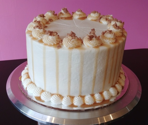 Apple Pie - Vanilla Cake, Filled with Apple Pie Filling, Topped with Vanilla Frosting, Streusel & Caramel.