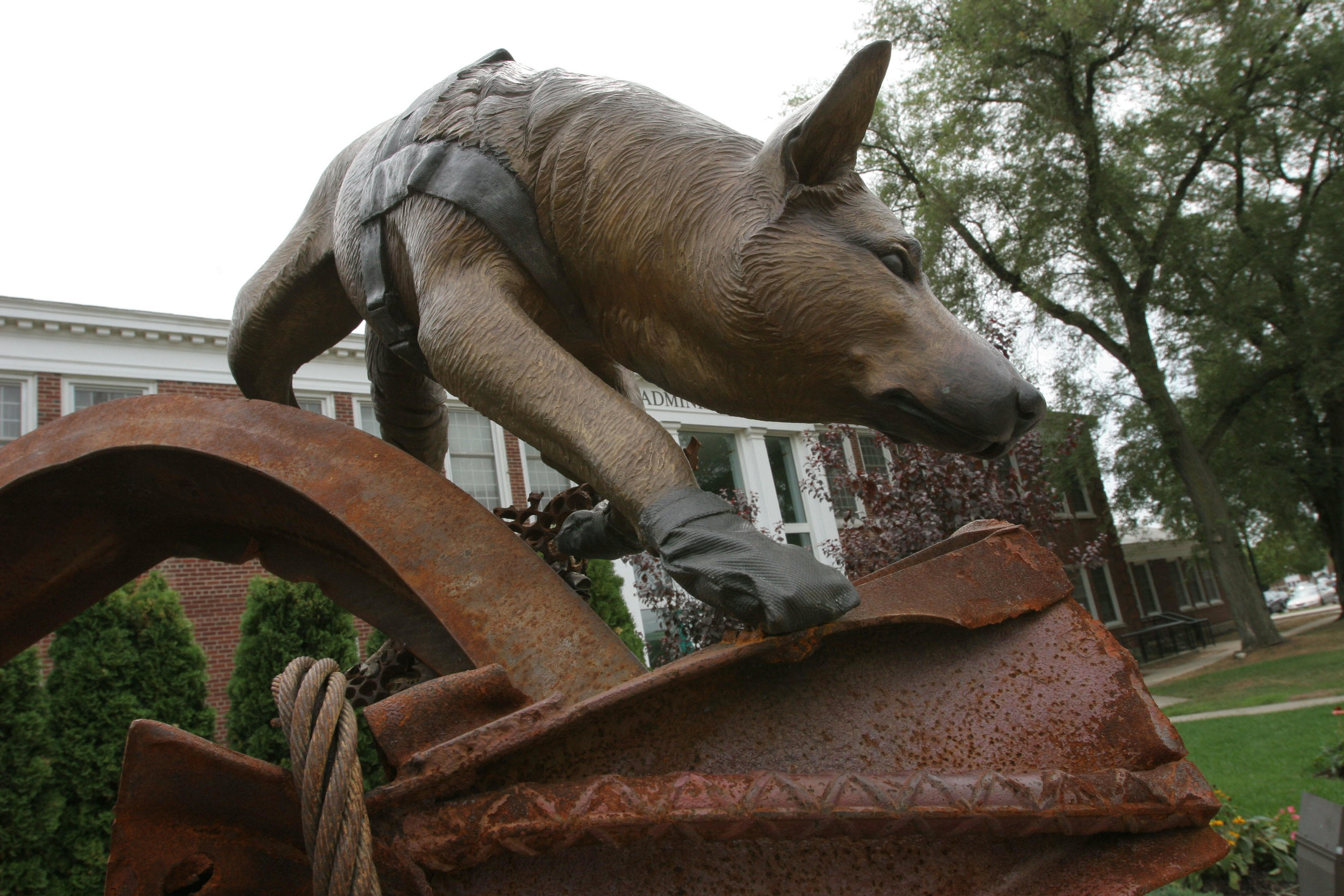 8/30/2005, Farmingdale. Photo shows 9/11 Memorial Garden. Bronze Sculpture of rescue dog searching among some original rubble from ground zero by Liza Todd-Tivey. Photo: Phil Marino