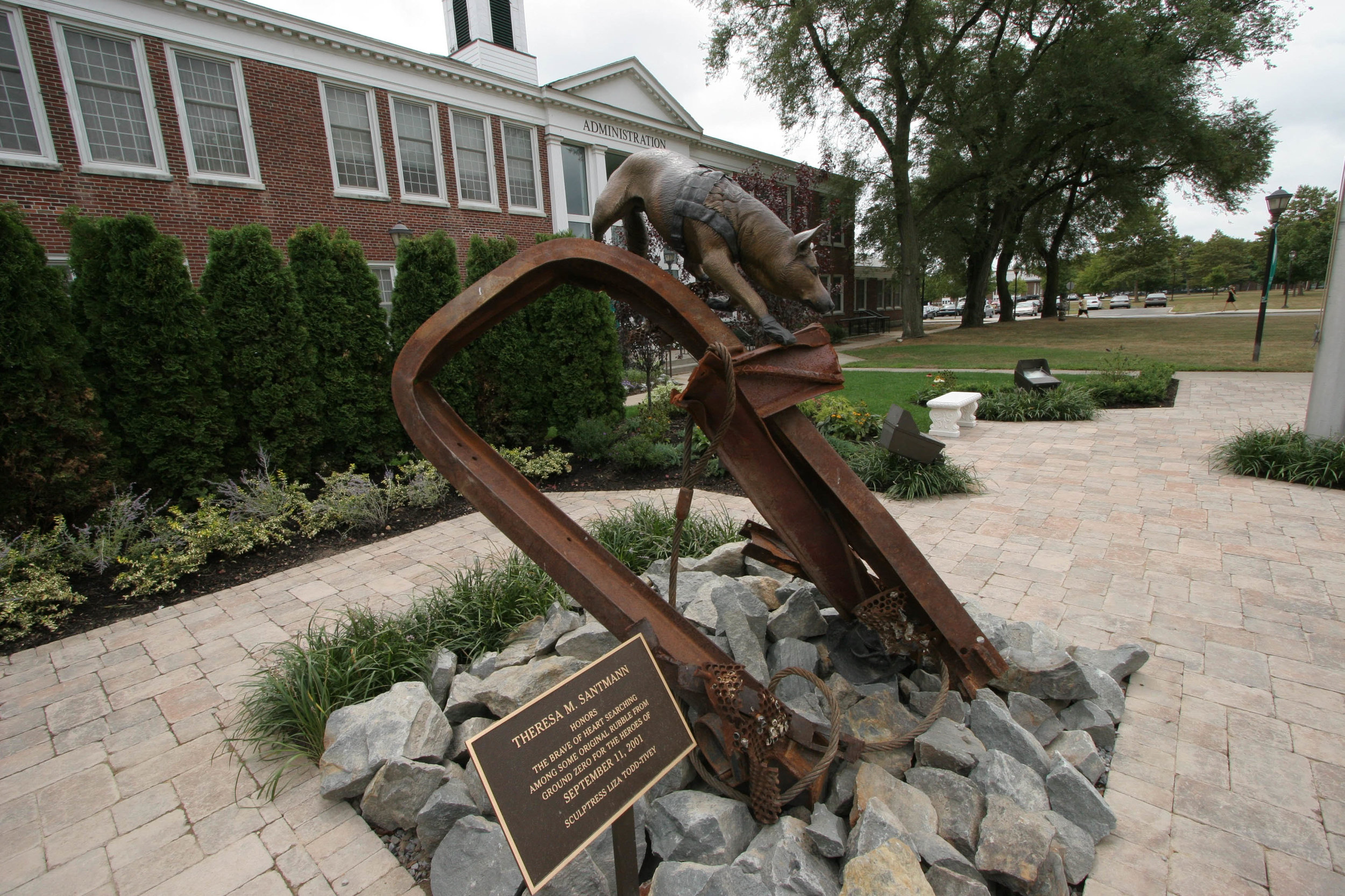 The second  911 Rescue Dog , made with the remaining scraps that Liza had obtained from Ground Zero, was donated by Theresa Santmann to the 911 Memorial Garden at Farmingdale State University on Long Island.