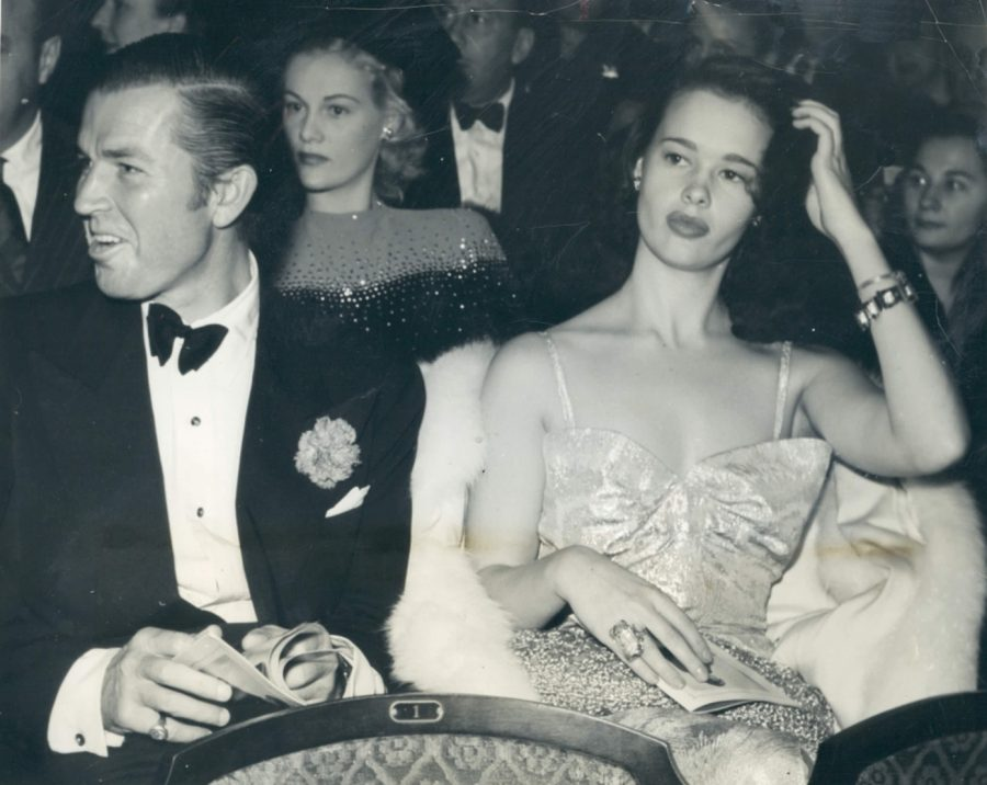 "17 year-old Gloria Vanderbilt (right) and actor Bruce Cabot (left) attend the 1941 Premiere of ""They Can't Get You Down""  Photo:  Acme"