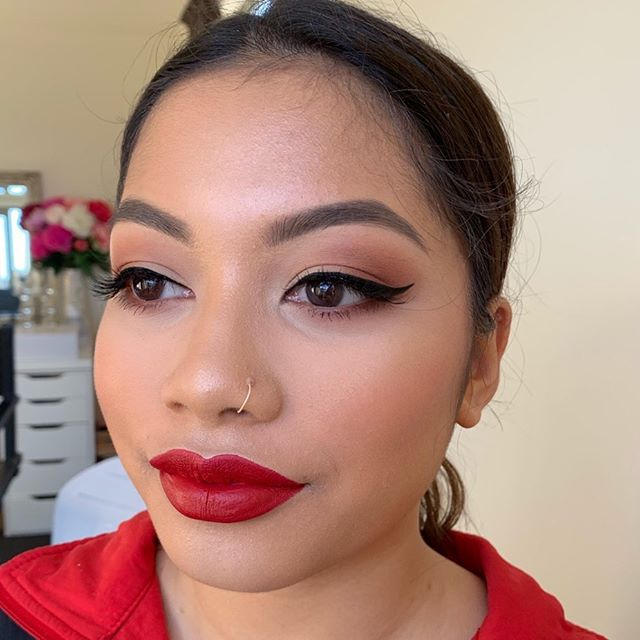 A classic wing and red lip for this formal babe!