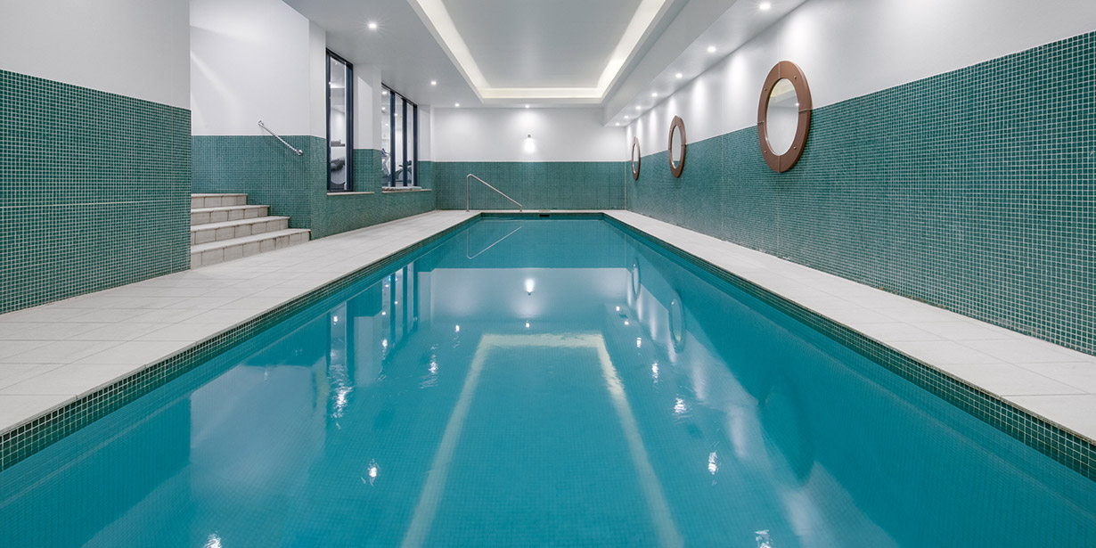 adina-apartment-hotel-coogee-sydney-one-bedroom-apartment-pool-02-2018-1230x615.jpg