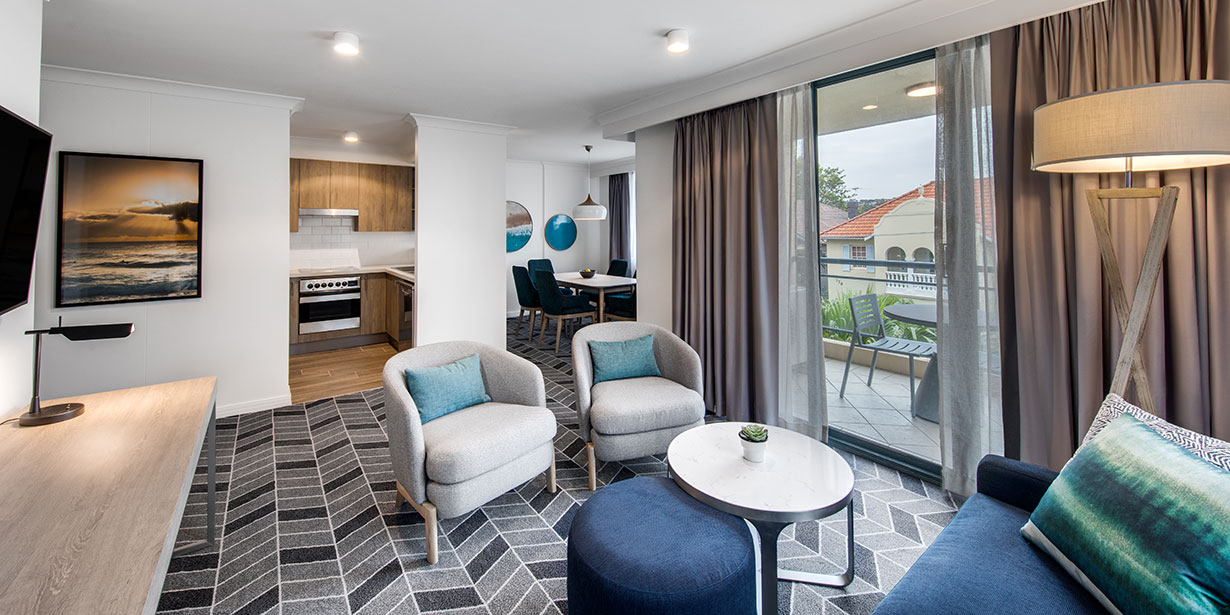 adina-apartment-hotel-coogee-two-bedroom-apartment-lounge-room-and-dining-02-2018-1230x615.jpg
