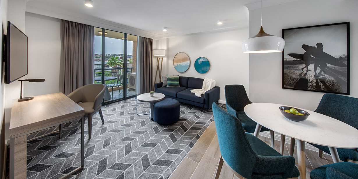adina-apartment-hotel-coogee-sydney-one-bedroom-apartment-lounge-room-and-dining-03-2018-1230x615.jpg