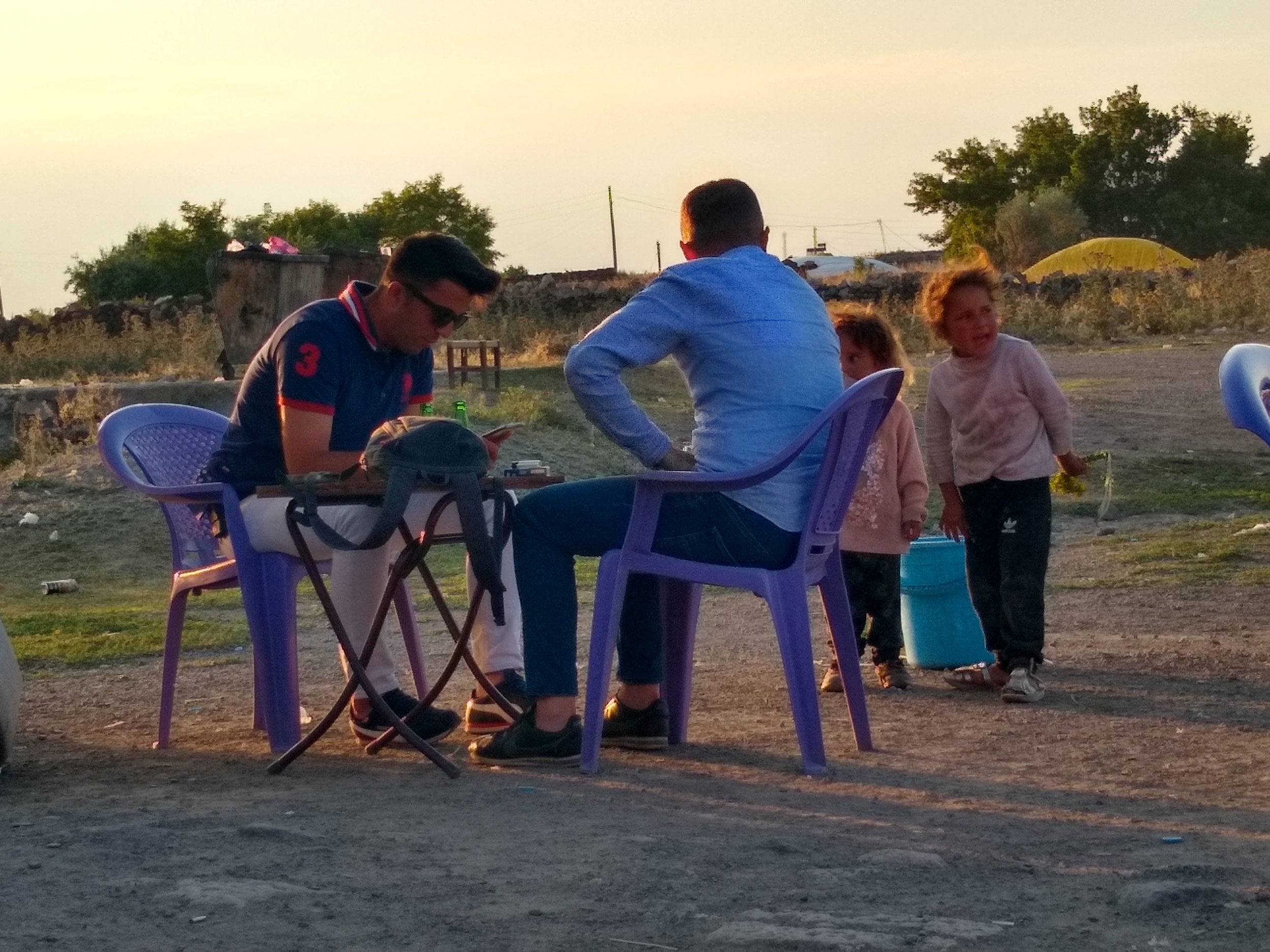 Two plain-clothes border patrol officers having tea.