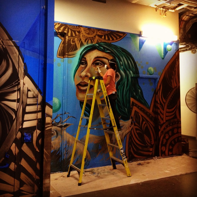 image: Erin Yoshi paints the first mural series at Yerba Buena Center for the Arts.